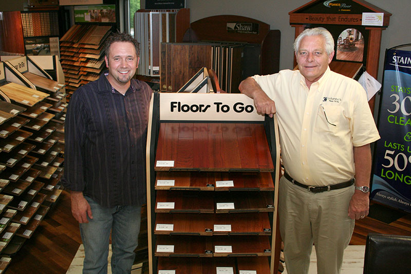 "Jim and Scott, circa 2005, showing off their new ""Floors To Go"" merchandising displays!"
